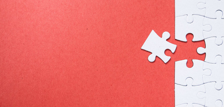 Jigsaw on red background