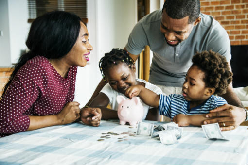 Happy family with piggy bank