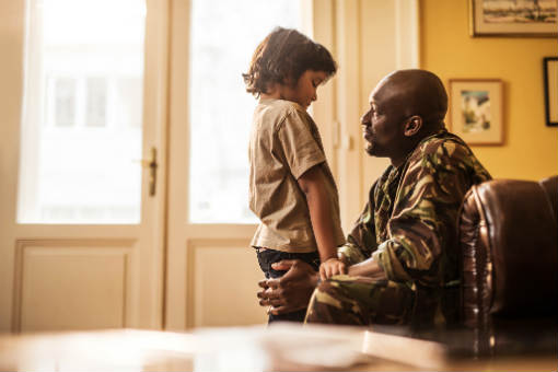 Military man and son talking