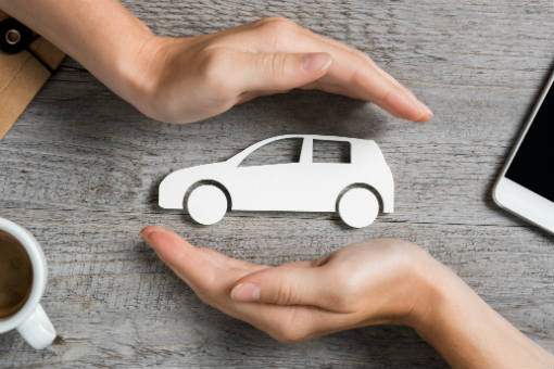 Figure of car between two hands