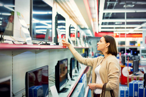 Woman shopping for a new TV