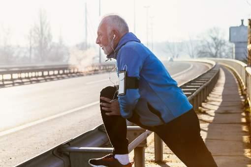 Older man getting ready to jog