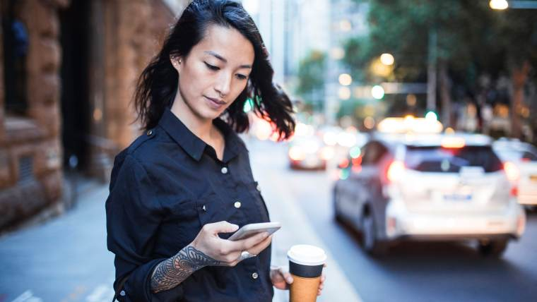 Woman reviewing financial apps on her smartphone