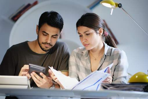 Hispanic couple reviewing their finances