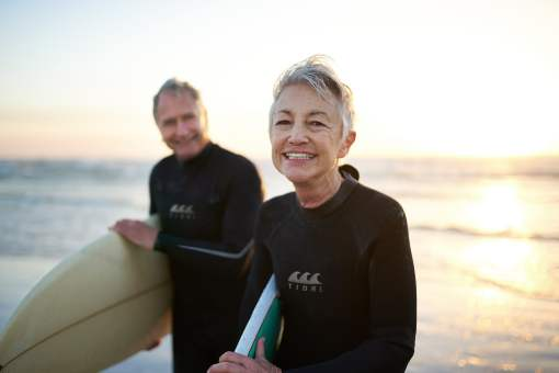 Senior couple surfing