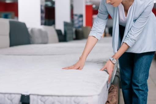Woman shopping for a new mattress