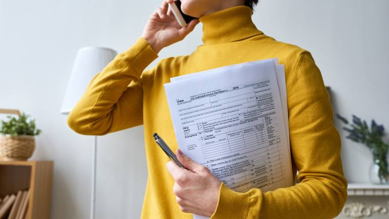 woman with tax return documents