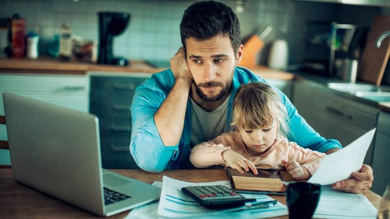 worried father reviewing finances with young daughter