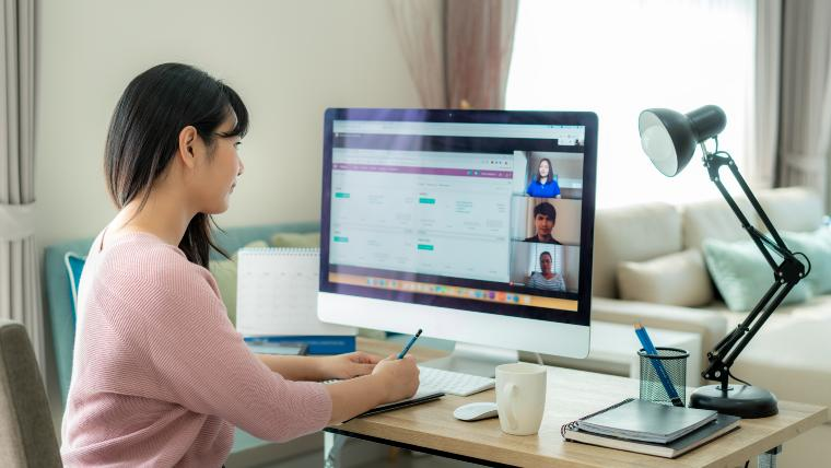 women working from home and participating in a virtual meeting
