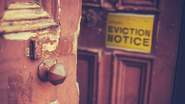 Eviction notice hanging on a door