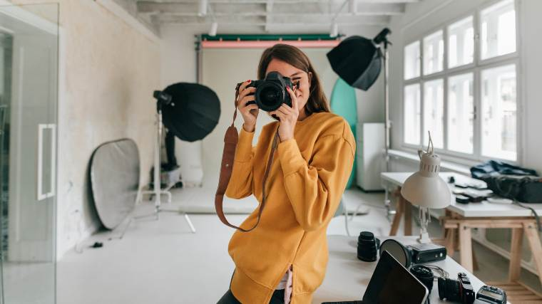 a freelance photographer in her studio