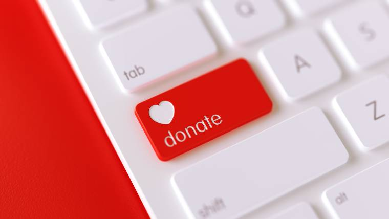 "laptop with a ""donate"" button"