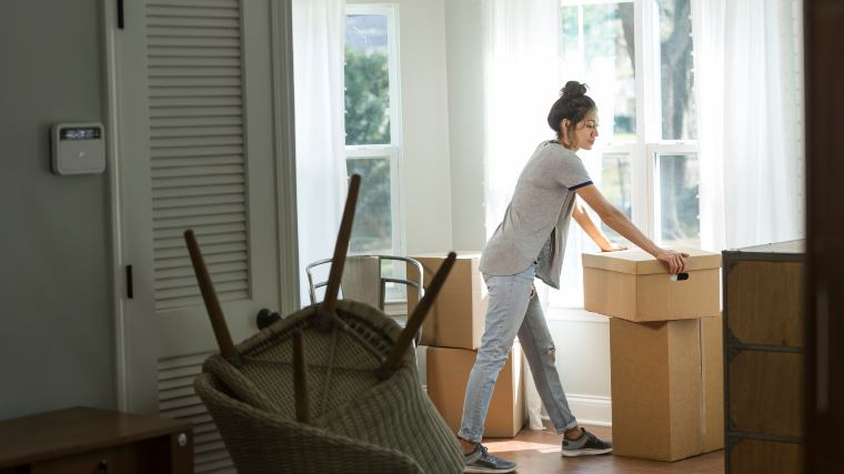 young woman moving out of an apartment