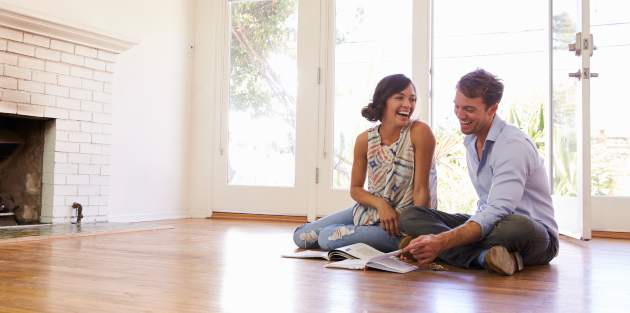 Couple looking at available house