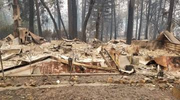 Ruined home following California wildfires