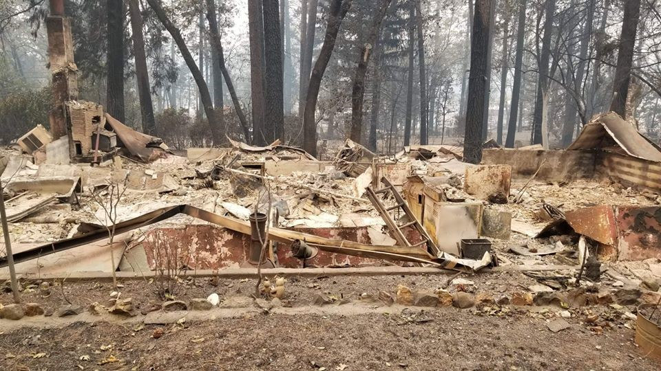 home devastated by wildfire